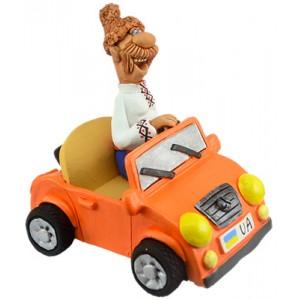 """Статуетка """"Козак на жовтогарячій машині"""""""