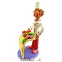 """Статуетка """"Шеф-кухар (жінка) за столом"""""""